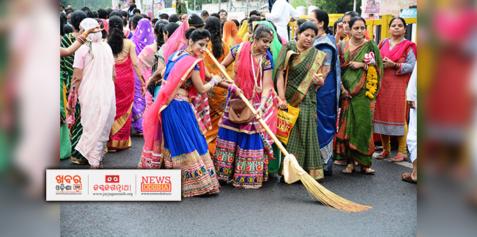 Women devotees cleaning road for Rath Yatra in Ujjain, MP