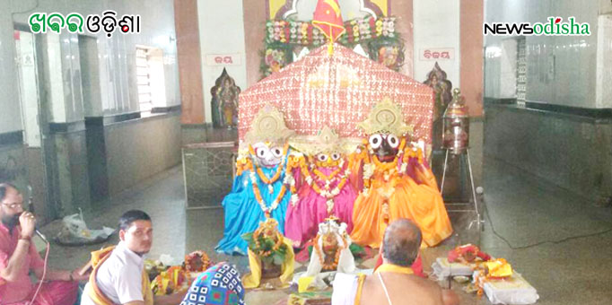 Priest performs ritual before the deities are taken to the chariot for Rath Yatra at Brajarajnagar in Jharsuguda