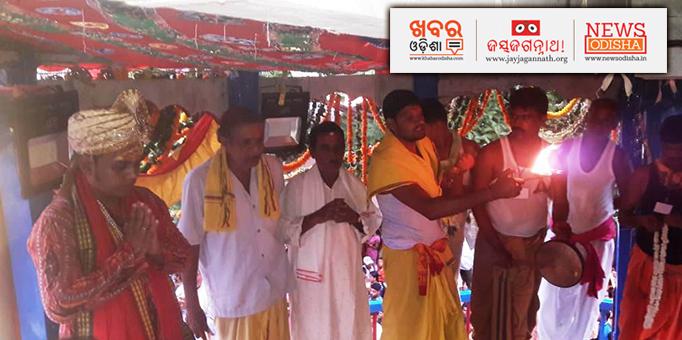 Servitors lighting Akhanda Deepa for the deities
