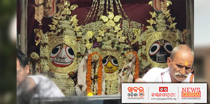 Lord Jagannath and His Siblings decorated and adorned with ornaments and flowers