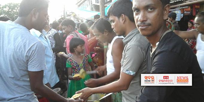 Prasad being distributed to devotees on Ratha Jatra at Malkangiri