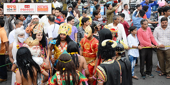Devotees dancing in gods and goddess attire at Ujjain on occasion of Rath Yatra