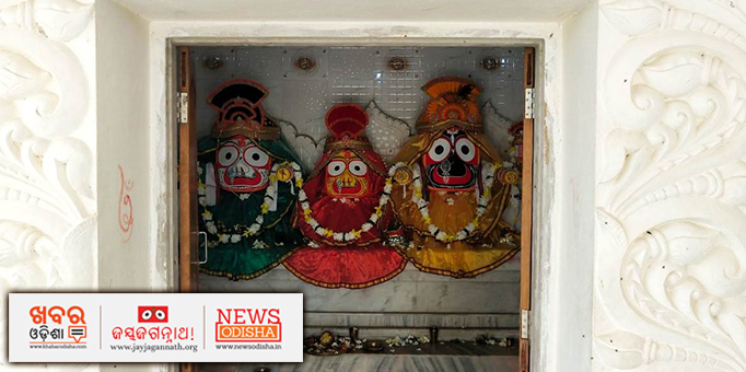 Lord Jagannath, Goddess Subhadra and Lord Balabhadra adorned in flowers and new clothes.