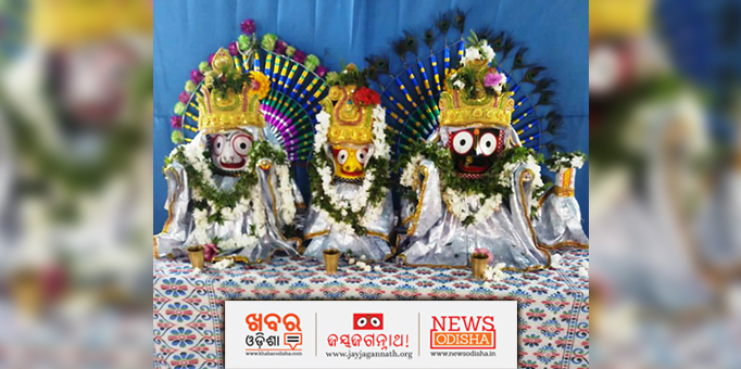 Holy Trinity accessorized with golden head gear ,new clothes and garlands of tulasi leaves.