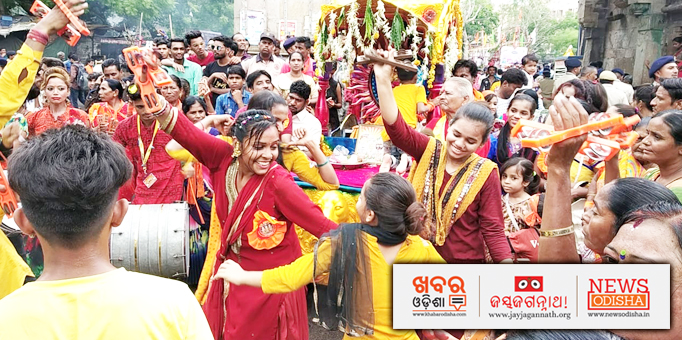 The devotees express joy through dancing in front of the chariot