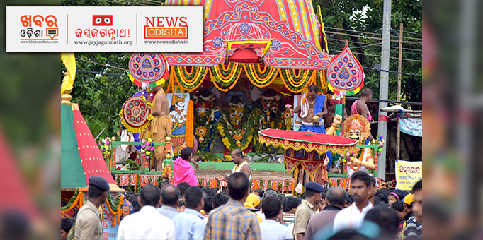 Holy Trinity wreathed in tulasi leaves on the chariot