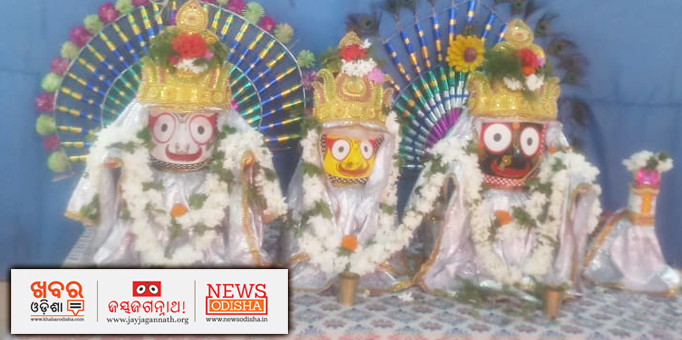 Holy Trinity ornamented with gold jewellery and garlands of flowers and tulasi leaves.