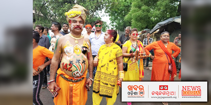 Lord   Jagannath and His siblings painted on a worshipper's body