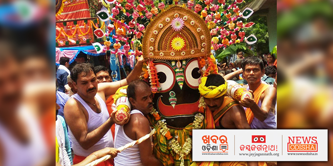 Servitors take Lord Jagannath to the chariot