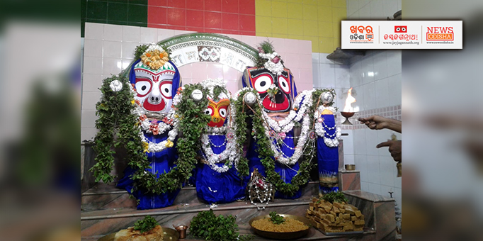 Holy Trinity adorned with flower and tulsi garlands at Berhampur
